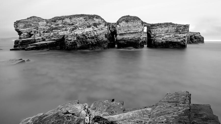 Black & white seascape taken at the Playa de Illa in Galicia, Spain.