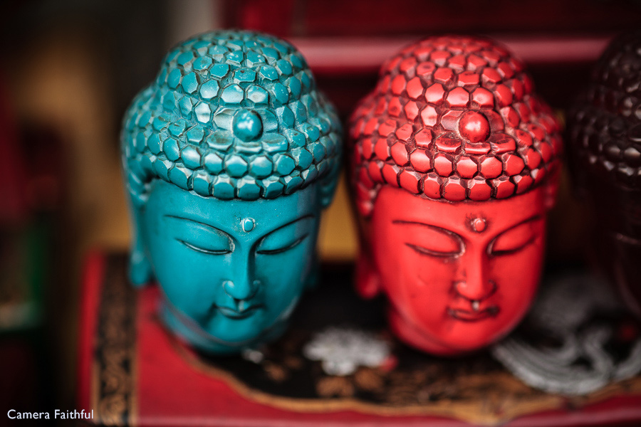 Close-up photo of ornamental Buddha heads taken in Dongtai Road Antiques Market, Shanghai, China